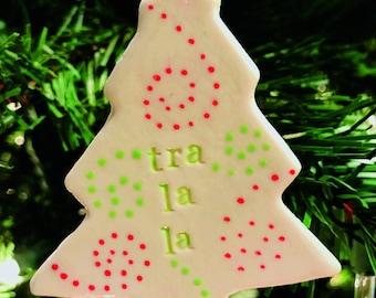 """Porcelain """"tra la la"""" tree ornament"""