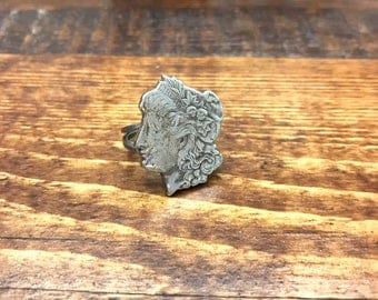 Antique 1880s U.S. Morgan silver dollar American coin statement ring featuring Lady Liberty