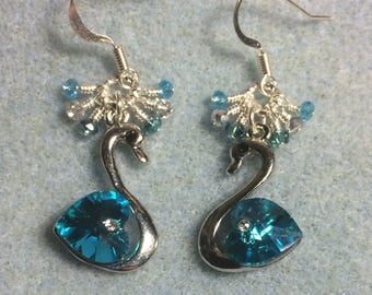 Silver and turquoise Sworovski crystal swan charm earrings adorned with tiny dangling turquoise and silver Chinese crystal beads.