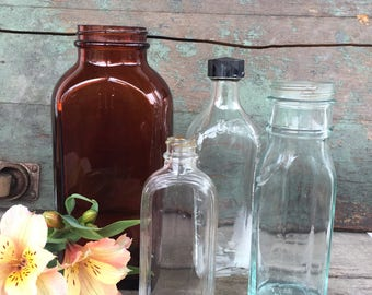 Group of Four Vintage and Antique Glass Bottles