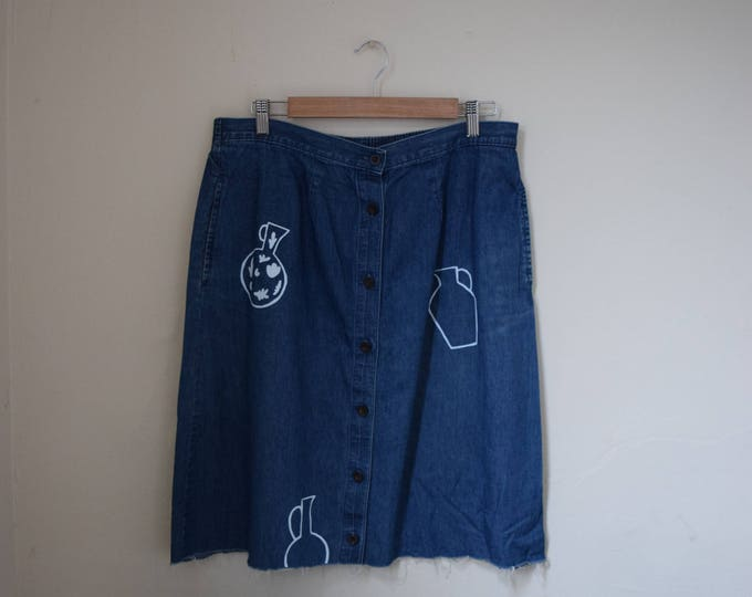 Daia Indigo Denim A-Line Skirt w/ Raw Hem.