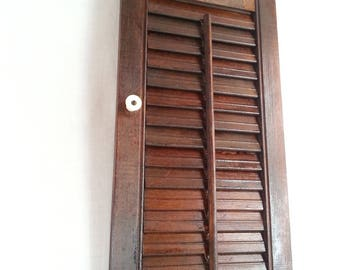 inside window shutters with movable louvers