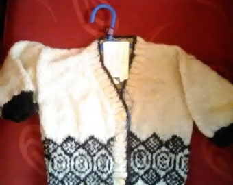 Hand knitted cardigan,  knitted with home spun wool, to fit a child aged 1-2 years old