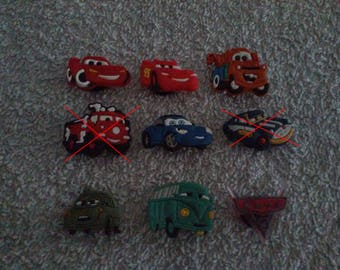 Lot 7 jibbitz Cars (badges for fangs)