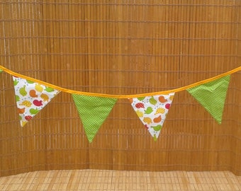Bunting fabric in shades of green, red, orange and yellow