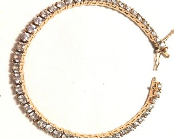 Gold over 925 sterling silver 50 cz tennis bracelet