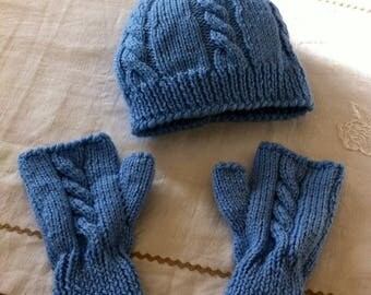 Blue fingerless gloves and wool hat