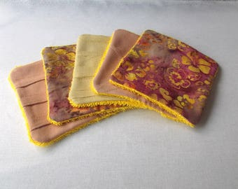 Cotton and sponge, purple and yellow colors, ecological wipes
