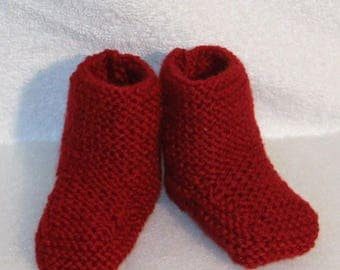 hand knitted red wool baby shoes