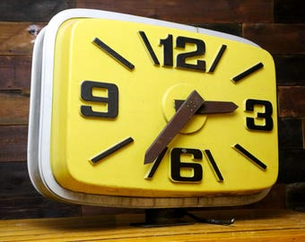 Large Vintage Double Sided Light Up Plastic Clock Store Front Outdoor Hanging Sign with Metal Base Mount Yellow Black Numbers Gas Station