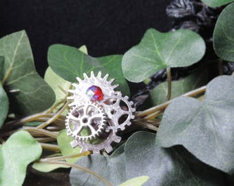Small red and silver steampunk brooch