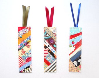 A set of three bookmarks made from scraps of cotton fabrics and recycled cardstock