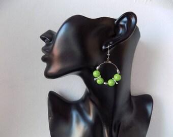Earrings rings green beads.