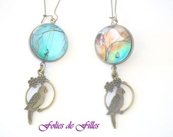 """""""The little girl and parrot"""" mismatched cabochon earrings"""