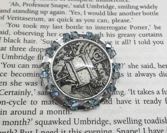 Harry potter inspired glass dome pin brooch. Recycled book page and Swarovski crystal beads