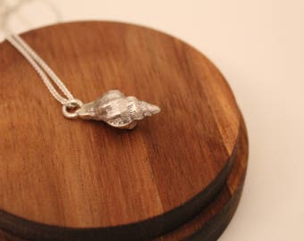 Silver Sea Shell with an Amethyst Drop