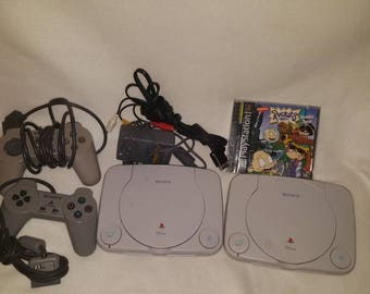 two vintage sony playstation 1 slim white scph101 game console working with