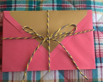 8 pack fushia pink and gold lined envelopes