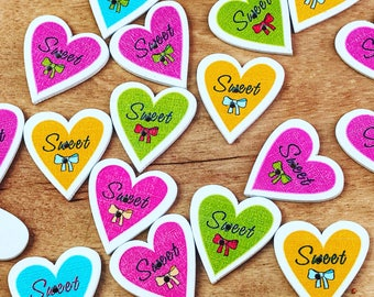 2 hole cute wood buttons, heart shaped buttons, cute mixed colors, sewing, crafts, scrapbooks, 10 per pack. Cute buttons