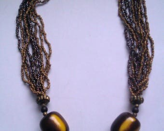 Tribal style micro bead multi strand necklace
