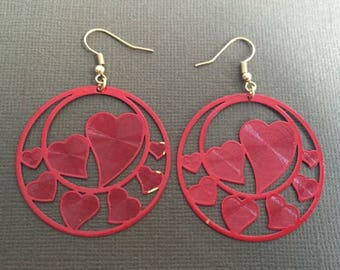 Earrings with red prints filled with hearts