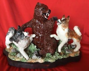 Akita's attacking a brown bear.