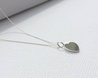 Necklace with heart plaque