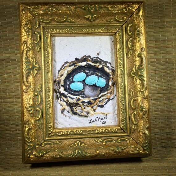 Fancy gold framed turquoise bird nest painting