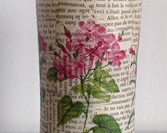 Decorated with papers glued glass vase