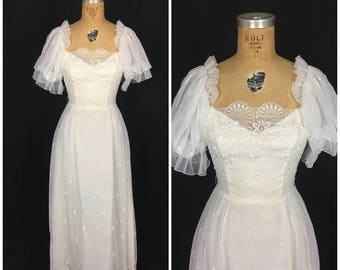 1970s White Floor Length Floral Wedding Dress with Puffed Sleeves 70s Ivory Flower Boho Maxi Eyelet Wedding Dress with Sheer Sleeves