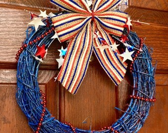 4th of July Patriotic Red White Blue Wreath with glitter, stars streamers and sparkles. Small and affordable