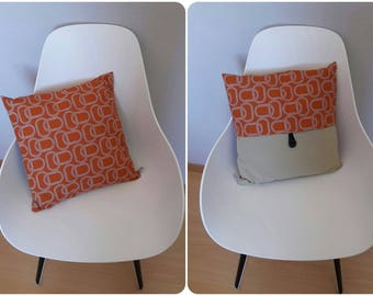 Pillow cover with geometric patterns in shades of orange and light taupe