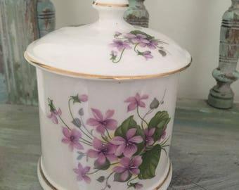Pretty floral violets crown Staffordshire preserve pot