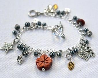 Hawaiian Charm Bracelet, Flower Charm Bracelet, Black and Silver Dangles, Mixed Metal Bracelet, Wooden Charm Bracelet, Tropical Charms