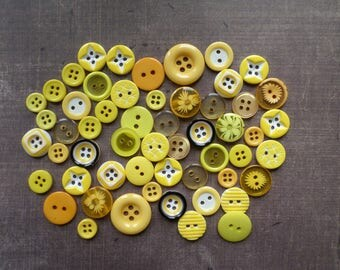 40 buttons round mix of size pattern color yellow