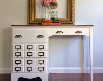 SOLD                    Three drawer vintage pure white desk with card catalog pulls 17.5d 43.5w 31.5h