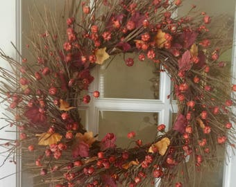 """22"""" Pumpkin and Leaves pip Berry wreath."""
