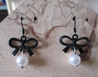 girls White Pearl and black metal earrings