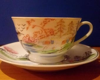 Antique Japenese tea cup and saucer with rare boat scene