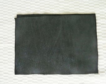 black leather size A4, waves effect, black satin, with reflections.