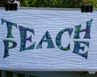 "Teach Peace quilted wallhanging in green and purple 10"" x 20"""