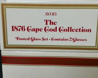 Avon Cape Cod  ruby red footed glasses.  Set of 4 in 2  Original boxes
