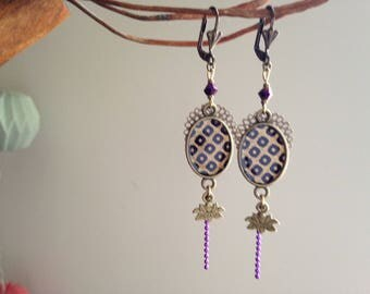 Earring in gold and purple Japanese paper.