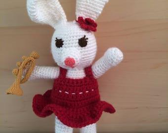 Crochet stuffed trumpet playing bunny rabbit plush