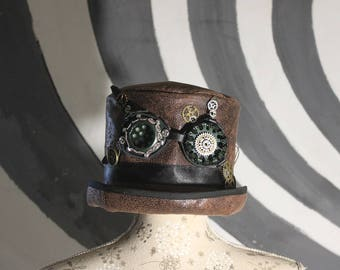 top hat with steampunk goggles