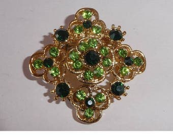 Dress or Scarf clip. maybe a brooch. Green stones