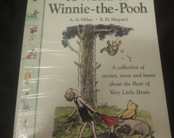 A World of Winnie the Pooh  A collection of stories, verses and hums about the Bear of little brain   By A A Milne. E H Shepard