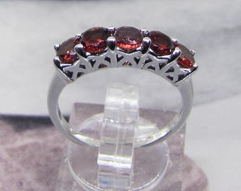 Size 58 on sterling silver Garnet ring