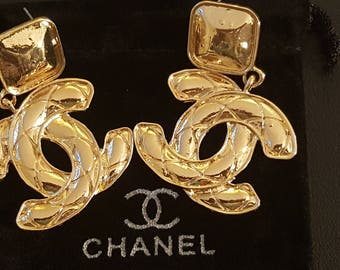 Chanel inspired gold coco chanel inspired fake post earrings for pierced ears.