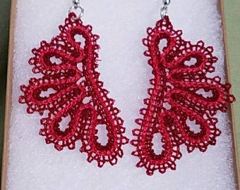 Delicate light weight embroidered earings.
